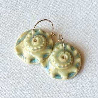 https://www.etsy.com/listing/470159291/porcelain-sunrise-shell-earrings-in?ref=shop_home_active_19